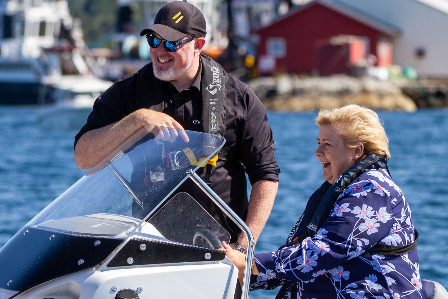Leif Stavøstrand with Norwegian Prime Minister Erna Solberg driving an electric boat